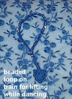 handbeaded wrist loop to carry train
